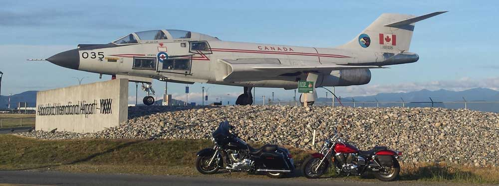 Motorcycles in front of royal canadian air force jet