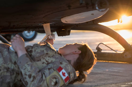 female airforce  member working maintenance