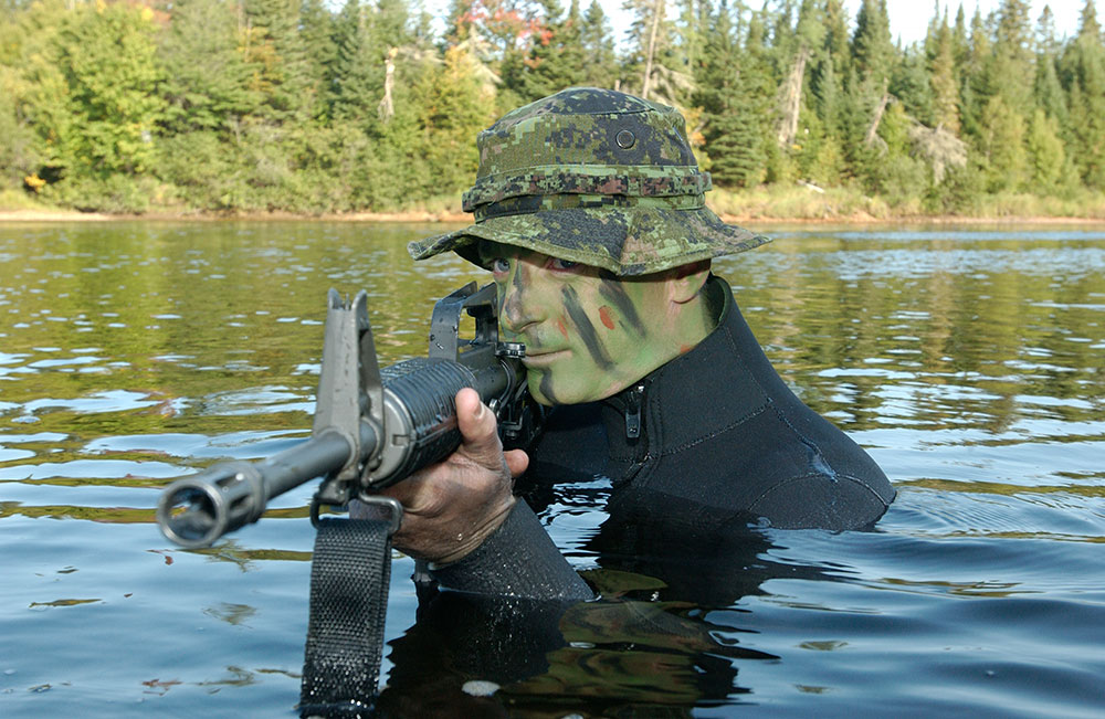 Ray G. military in water with rifle